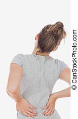 Woman suffering from backache - Rear view of woman suffering...