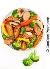 Grilled kielbasa and vegetables - A dish of grilled...
