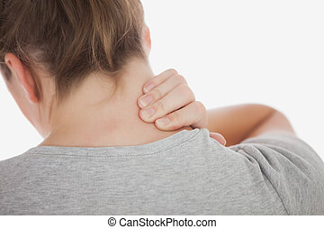 Close-up of woman suffering from neckache