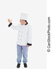 Confident chef showing something on white