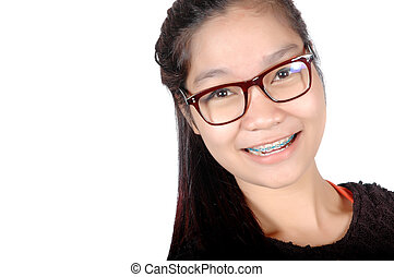 portrait of asian young girl with glasses and braces...