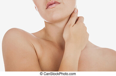 Woman massaging neck against white background