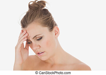 Woman with headache - Young woman with headache over white...