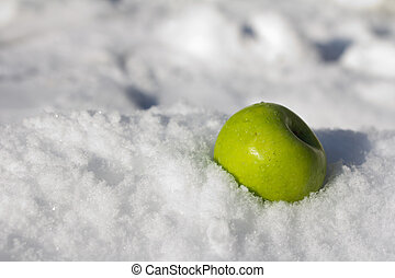 green apple in the snow