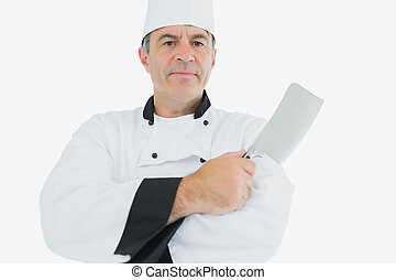 Chef holding meat cleaver - Portrait of confident chef...