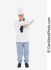 Man in chef uniform holding meat cleaver - Full length...