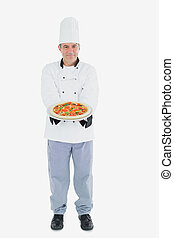 Mature male chef holding pizza - Full length portrait of...