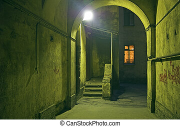 Backyard of old buildings at night