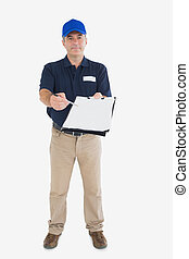 Mature delivery person holding out clipboard - Portrait of...