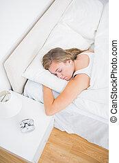 High angle view of woman sleeping - High angle view of woman...