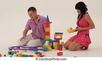 Building a castle - Two grown-ups building a toy castle