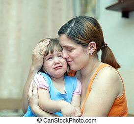 woman soothes crying daughter Focus on woman