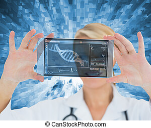 Woman holding a virtual screen - Smiling nurse holding a...
