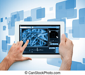 Hand holding and touching a medical digital tablet on a...