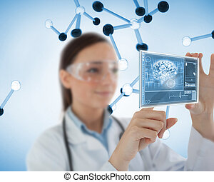 Smiling woman holding a virtual screen showing brain