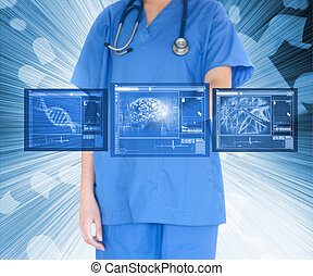 Nurse working with touch screen standing against a...