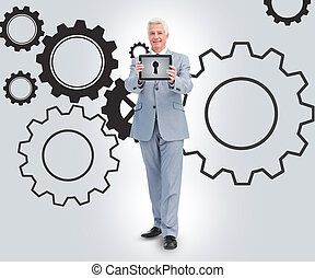 Businessman standing against a cogs background - Businessman...