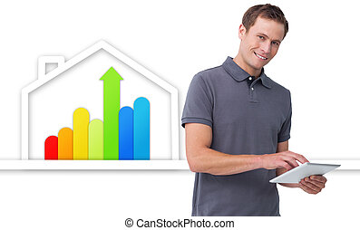 Man using tablet against energy efficient house graphic -...