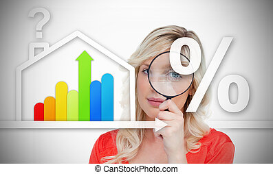 Woman standing behind energy efficient house graphic with...