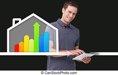 Man standing behind energy efficient house graphic - Smiling...