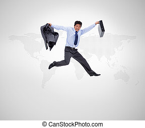 Businessman in suit jumping against a grey background
