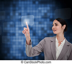 Businesswoman pressing button on touch screen against a blue background
