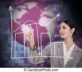Brunette businesswoman using graphical presentation on touch...