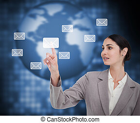 Businesswoman pointing on envelope against the background
