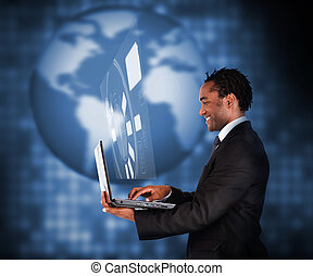 View of businessman using laptop