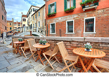 Typical view on small street in Venice, Italy. - Wooden...