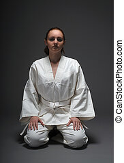 Girl in white kimono, traditional stance of aikido - Girl in...