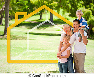 Happy family in the park with house