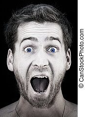 screaming guy with mouth wide open - portrait of a young...