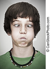 cross-eyed young teenager boy - portrait of cross-eyed young...