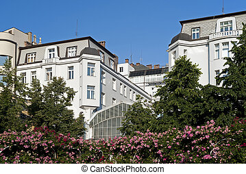 Prague - Secession buildings in the garden with roses