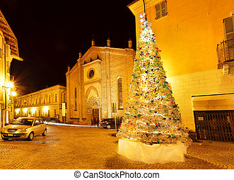 Christmas tree on small plaza. Alba, Italy. - Illuminated...