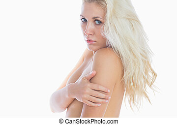 Sensuous woman covering her breasts - Portrait of sensuous...