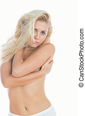 Topless young woman embracing herself - Portrait of topless...