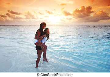 Happy women playing in water