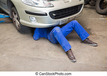 Mechanic under car - Male mechanic under car