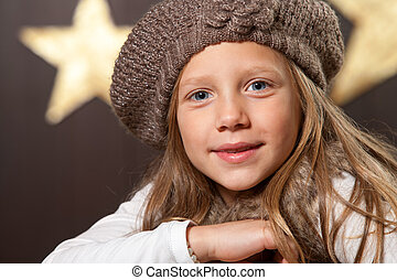 Close up of cute girl wearing beanie.