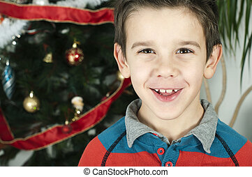 Happy children in front of Christmas tree