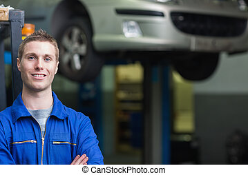 Confident male auto mechanic - Portrait of confident male...