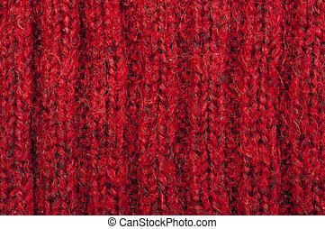 Handmade knit red background. Close up structure of the yarn