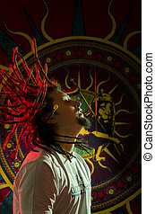 Motion - Shot portrait of a young rastaman with his...