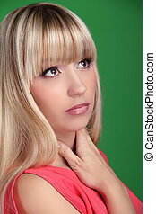 Portrait of a beautiful female model on green background