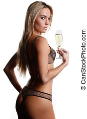 beautiful woman in lingerie drinking champagne