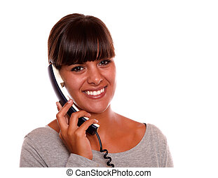 Friendly young woman speaking on phone - Portrait of a...