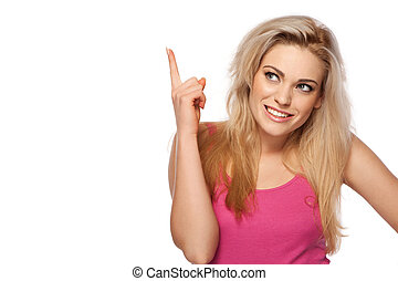 Beautiful young woman pointing her finger