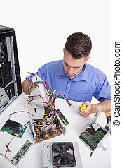 Young computer engineer working on cpu parts